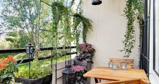 Der Torbogen auf diesem Balkon ist eine brillante Idee. Es bietet mehr Privatsphäre und viel Grün, damit sich der Raum wie ein echter Garten anfühlt - Bart Lardinois