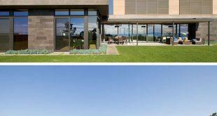 Dieses Haus hat ein freitragendes Esszimmer mit Wänden aus Glas